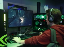 A gamer plays a video game on a computer equipped with a Nvidia GeForce RTX graphic card