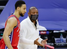 Head coach Doc Rivers of the Philadelphia 76ers speaks with Ben Simmons