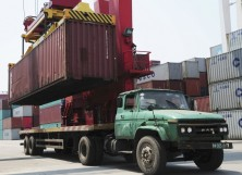 A crane loads a container onto a truck at a port in Qingdao, Shandong province.